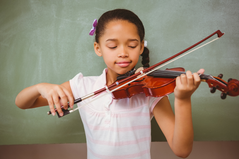 http://www.dreamstime.com/royalty-free-stock-photos-portrait-cute-little-girl-playing-violin-classroom-image50488198